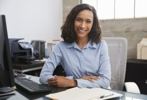 Young woman sitting at a desk in an office